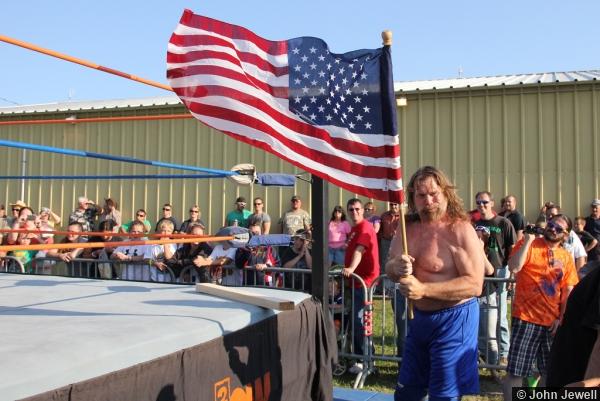 Hacksaw Jim Duggan with the American flag